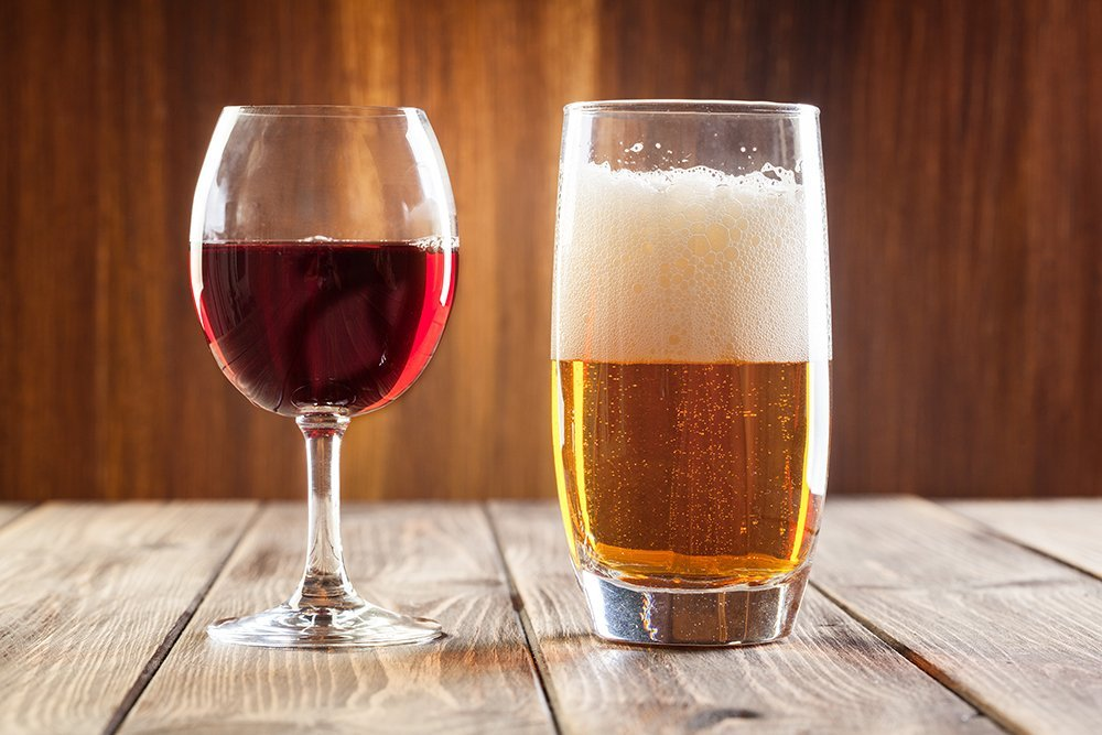 Red wine glass and glass of light beer